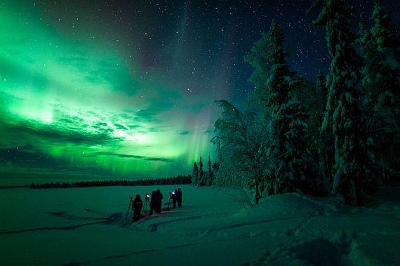 Северное сияние в Финляндии зимой
